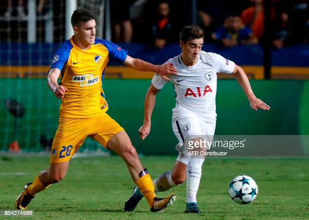 Tottenham's English midfielder Harry Winks is marked by APOEL Nicosia's Hungarian midfielder Roland Sallai during the UEFA Champions League football...