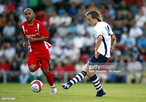 Tottenham's Luka Modric and Leyton Orient's Adam Chambers battle for the ball during the PreSeason Friendly at the Matchroom Stadium Leyton