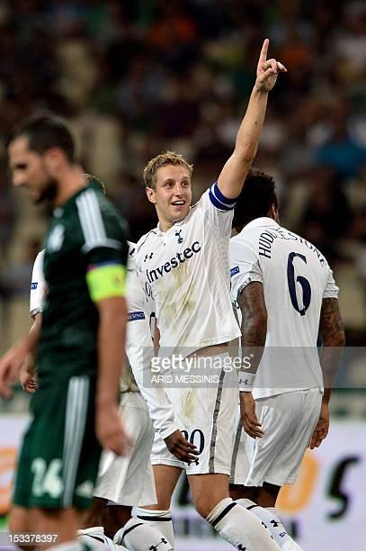 Tottenham's Michael Dawson celebrates after scoring against Panathinaikos during the group stage Europa League football game between Panathinaikos...