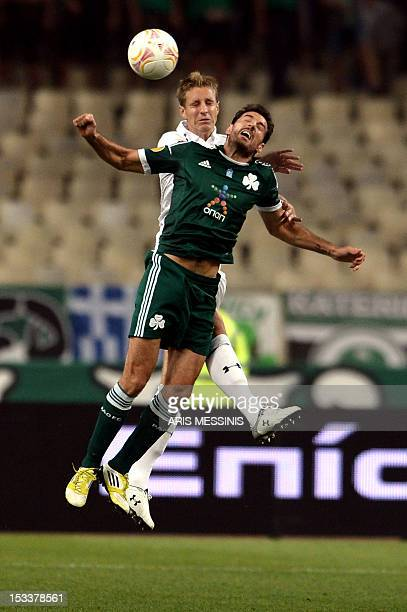 Tottenham's Michael Dawson jumps for the ball along with Toche of Panathinaikos during the group stage Europa League football game between...