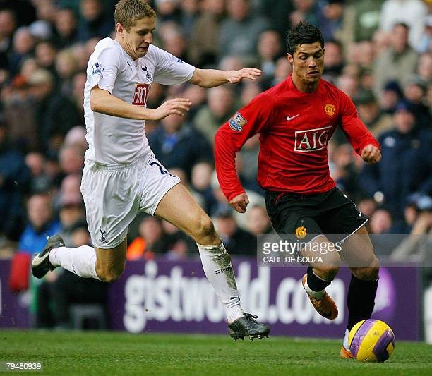 Tottenham's Michael Dawson vies with Manchester United's Cristiano Ronaldo during their Premiership match at home to Tottenham Hotspur at White Hart...