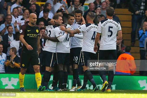 Tottenham's players celebrate taking the lead after Manchester City's Serbian defender Aleksandar Kolarov's own goal during the English Premier...