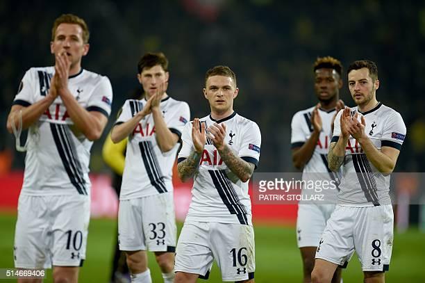 Tottenham´s players react after during the UEFA Europe League Round of 16 first leg football match between Borussia Dortmund and Tottenham Hotspurs...