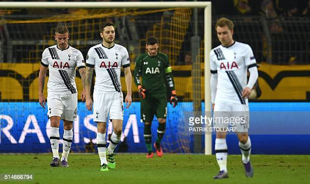 Tottenham´s players react during the UEFA Europe League Round of 16 first leg football match between Borussia Dortmund and Tottenham Hotspurs in...