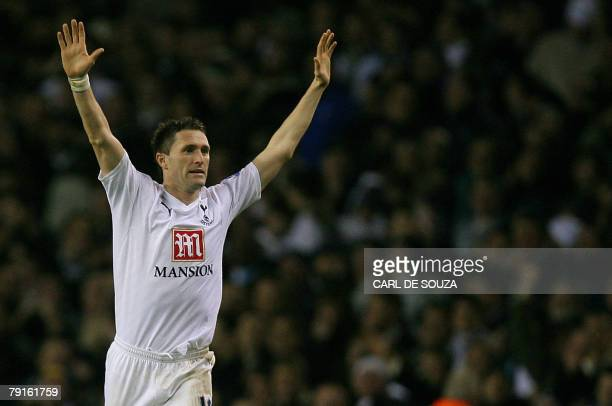 Tottenham's Robbie Keane celebrates after scoring the third goal of the match during the second leg of their Carling Cup Semi Final against Arsenal...