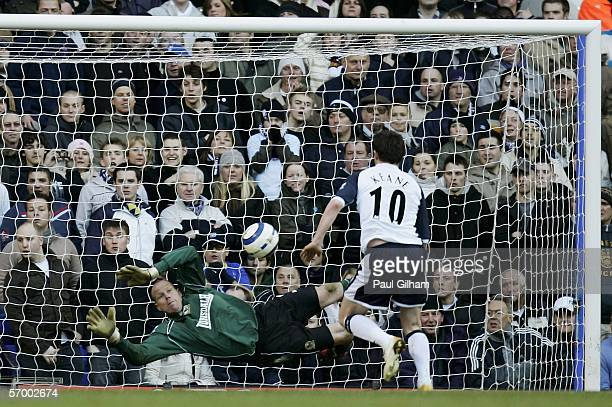 Tottenhams Robbie Keane shoots past Brad Friedel of Blackburn to score his second goal during the Barclays Premiership match between Tottenham...