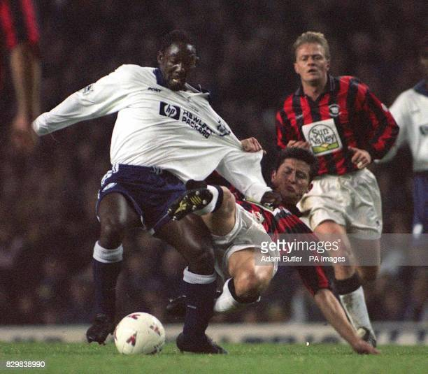 Tottenham's Sol Campbell staves off Hereford's Murray Fishlock during their FA Cup third round replay at White Hart Lane