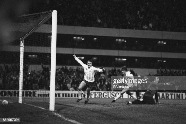 Tottenham's Terry Gibson raises his arms in triumph as he scores with Glenn Hoddle in support passed floored Burnley goalkeeper Alan Stevenson The...