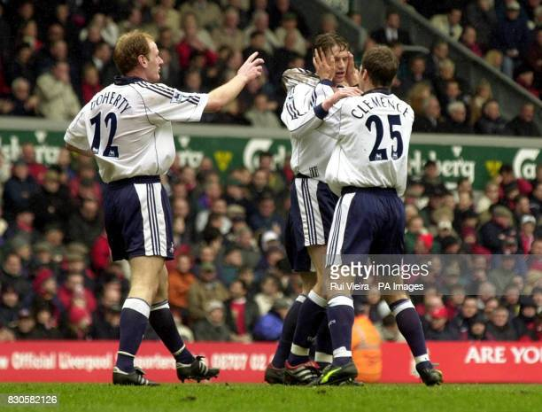 LEAGUE Tottenham's Willem Korsten is congratulated by Stephen Clemence and gary Doherty after scoring the equalizer against Liverpool during the FA...