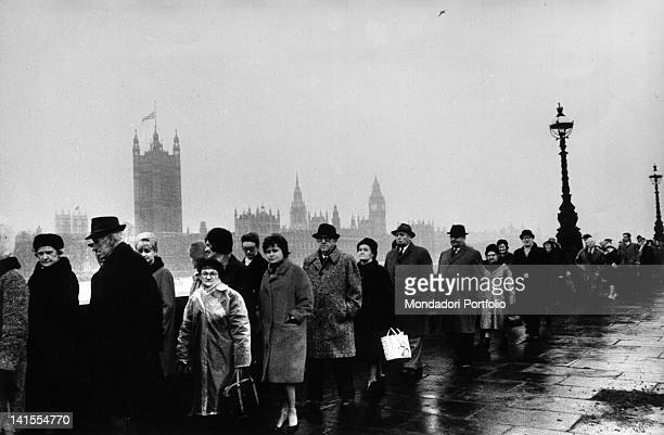 Touched crowd forming a queue to pay homage to the coffin of British exPrime Minister Winston Churchill London 30th January 1965