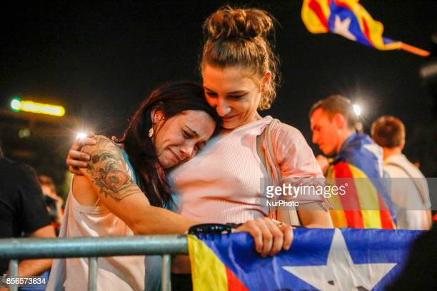 Touched girls celebrate the electoral vittory of quotSiquot in Barcelona's Plaza Catalunya waiting for electoral results on 1st October 2017
