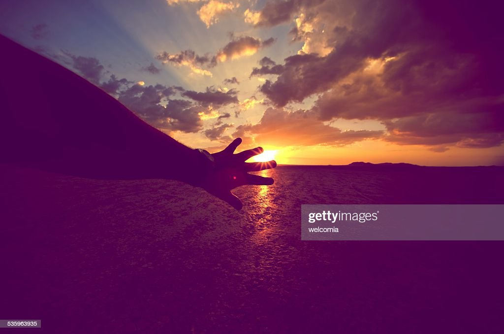 Touching the Sun : Stock Photo