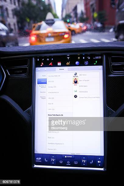 A touchscreen control panel displays entertainment features just prior to the Tesla Motors Inc 80 software update inside a Model S P90D vehicle in...