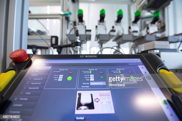 A touchscreen control panel sits beside a Bosch Rexroth machine during an assembly line industry 40 simulation inside the new Robert Bosch GmbH...