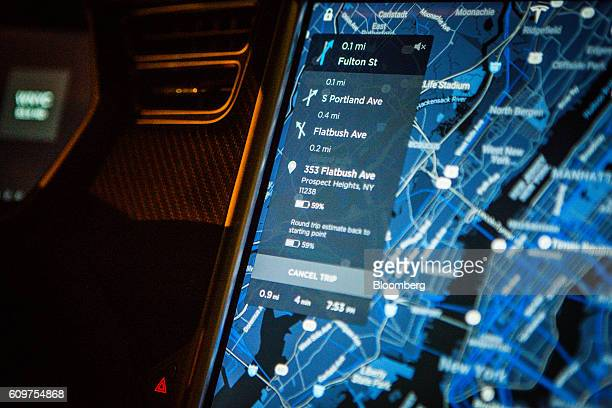 A touchscreen control panel with the Tesla Motors Inc 80 software update displays a map navigation feature inside a Model S P90D vehicle in the...