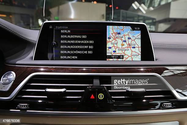 A touchscreen displays a map of Germany on the dashboard of new BMW 7Series X Drive plugin hybrid automobile manufactured by Bayerische Motoren Werke...