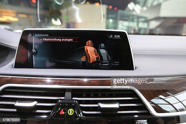 A touchscreen displays seat reclining options on the dashboard of new BMW 7Series X Drive plugin hybrid automobile manufactured by Bayerische Motoren...