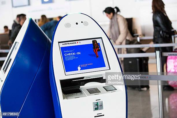 A touchscreen selfservice passenger checkin machine stands at the Air FranceKLM Group checkin desk inside Charles De Gaulle airport operated by...