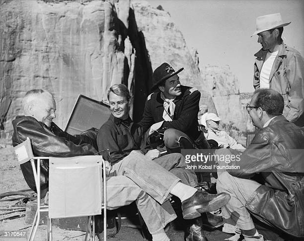 Tough guy actor Alan Ladd enjoys a joke with director William Dieterle during the location shoot of the 1951 western 'Red Mountain' Fellow Actor John...