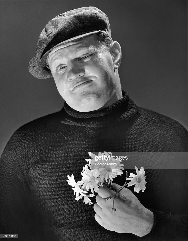 Tough guy with daisies.