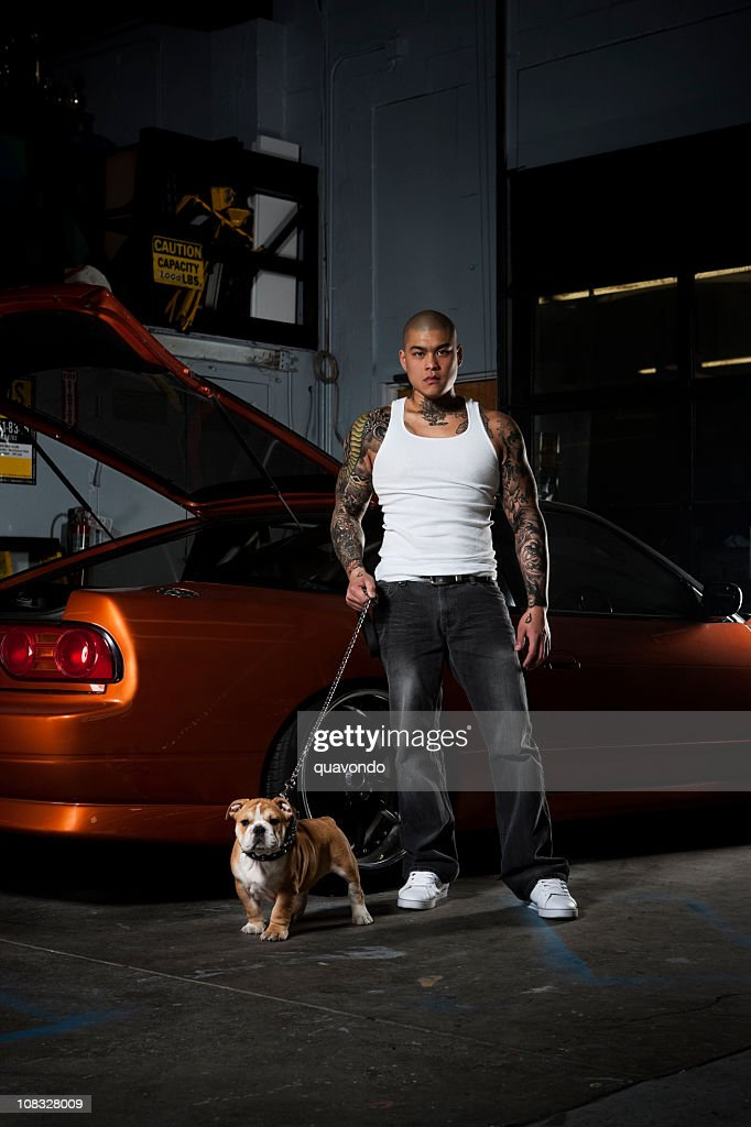Asian Male with Bulldog, Tattoos, and Race Car, Copy Space : Photo