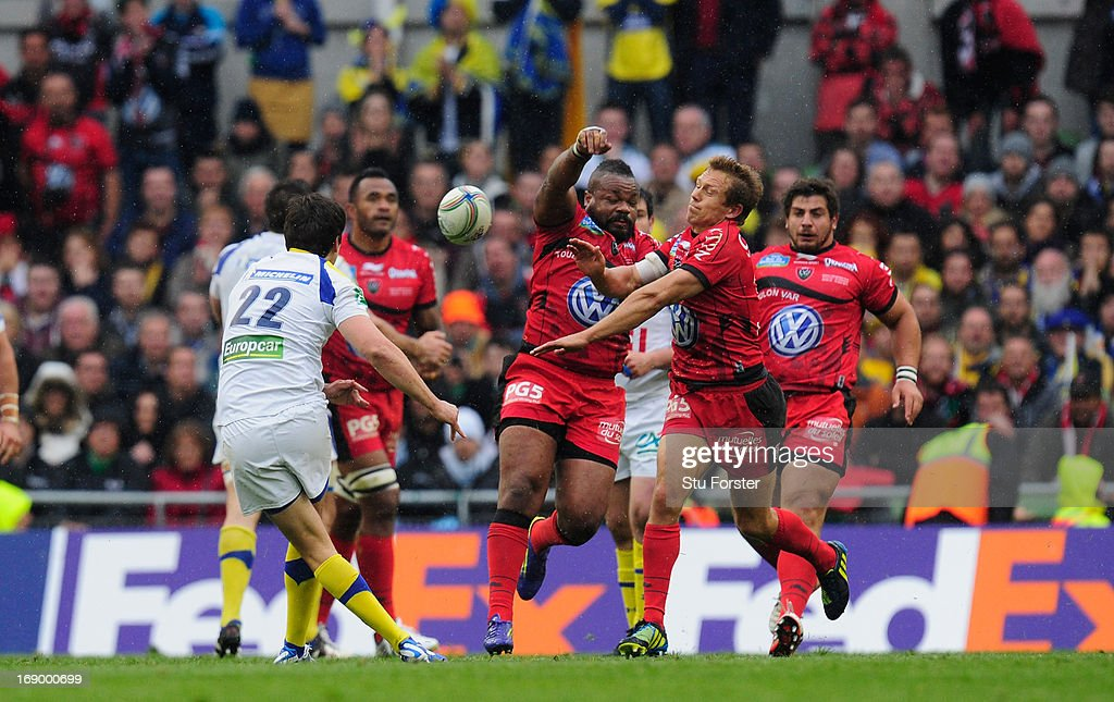 Toulon captain <a gi-track='captionPersonalityLinkClicked' href=/galleries/search?phrase=Jonny+Wilkinson&family=editorial&specificpeople=159417 ng-click='$event.stopPropagation()'>Jonny Wilkinson</a> (r) and <a gi-track='captionPersonalityLinkClicked' href=/galleries/search?phrase=Mathieu+Bastareaud&family=editorial&specificpeople=677501 ng-click='$event.stopPropagation()'>Mathieu Bastareaud</a> (c) combine to thwart the drop goal attempt of <a gi-track='captionPersonalityLinkClicked' href=/galleries/search?phrase=David+Skrela&family=editorial&specificpeople=596534 ng-click='$event.stopPropagation()'>David Skrela</a> during the Heineken Cup final match between Clermont Auvergne and Toulon at Aviva Stadium on May 18, 2013 in Dublin, Ireland.