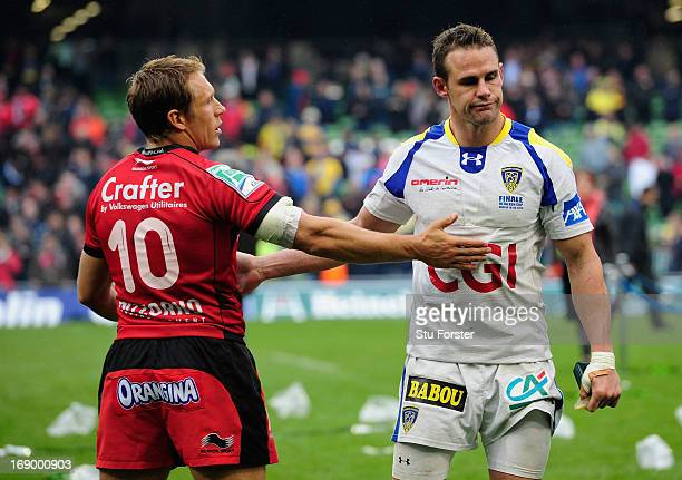 Toulon captain Jonny Wilkinson consoles Clermont fullback Lee Byrne after the Heineken Cup final match between Clermont Auvergne and Toulon at Aviva...