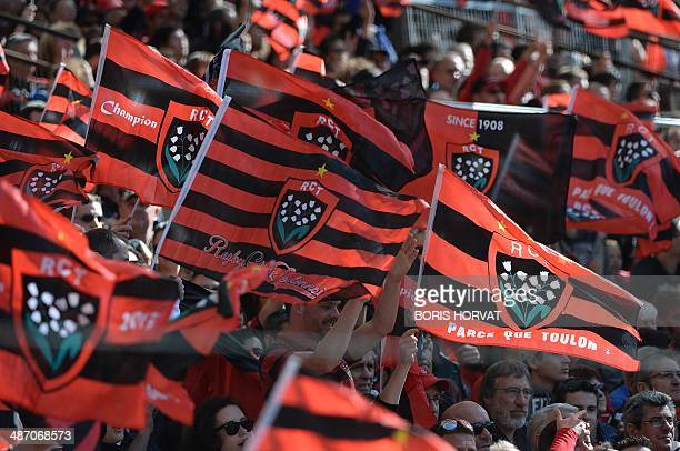 Toulon fans wave team flags during the Rugby Union European Cup semifinal match between Toulon and Munster at the Velodrome stadium in Marseille on...
