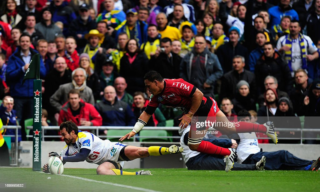 Toulon player <a gi-track='captionPersonalityLinkClicked' href=/galleries/search?phrase=Chris+Masoe&family=editorial&specificpeople=540337 ng-click='$event.stopPropagation()'>Chris Masoe</a> (r) fails to halt <a gi-track='captionPersonalityLinkClicked' href=/galleries/search?phrase=Brock+James&family=editorial&specificpeople=636412 ng-click='$event.stopPropagation()'>Brock James</a> of Clermont attempting to touchdown but The try wasnt given during the Heineken Cup final match between Clermont Auvergne and Toulon at Aviva Stadium on May 18, 2013 in Dublin, Ireland.