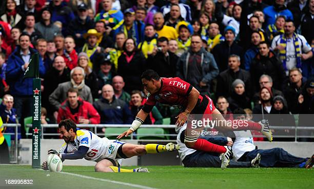 Toulon player Chris Masoe fails to halt Brock James of Clermont attempting to touchdown but The try wasnt given during the Heineken Cup final match...