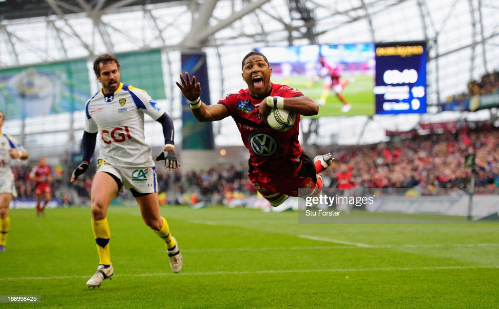 Toulon player <a gi-track='captionPersonalityLinkClicked' href=/galleries/search?phrase=Delon+Armitage&family=editorial&specificpeople=556925 ng-click='$event.stopPropagation()'>Delon Armitage</a> dives in for a try watched by <a gi-track='captionPersonalityLinkClicked' href=/galleries/search?phrase=Brock+James&family=editorial&specificpeople=636412 ng-click='$event.stopPropagation()'>Brock James</a> of Clermont during the Heineken Cup final match between Clermont Auvergne and Toulon at Aviva Stadium on May 18, 2013 in Dublin, Ireland.