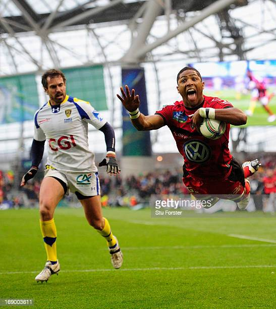 Toulon player Delon Armitage dives in for a try watched by Brock James of Clermont during the Heineken Cup final match between Clermont Auvergne and...