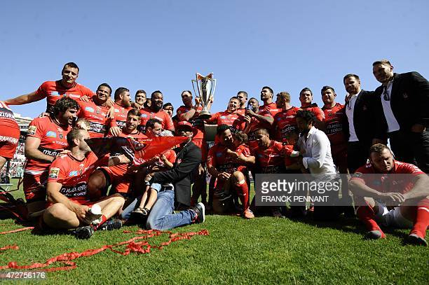 RC Toulon players hold the European Champions Cup trophy as they celebrate after winning the French Top 14 rugby union match between RC Toulon and...