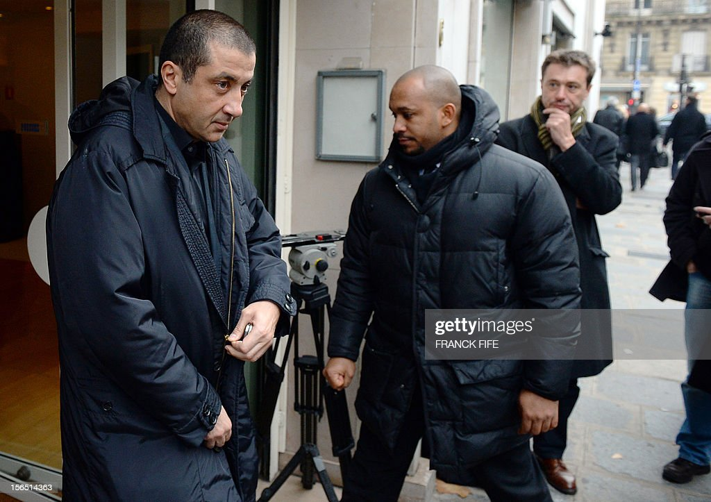 Toulon rugby team president Mourad Boudjellal (L) leaves on November 16, 2012 in Paris, after attending the election of the new head of the French national rugby league (LNR), which oversees the professional 15-a-side game in France. Paul Goze, 61, received a four-year mandate as head of the body that manages the Top 14 and Pro D2 divisions, succeeding Pierre-Yves Revol, who was elected in 2008 to take over from former France full-back Serge Blanco (1998-2008). AFP PHOTO / FRANCK FIFE