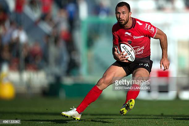 RC Toulon's Australian flyhalf Quade Cooper runs with the ball during the French Top 14 rugby union match between RC Toulon and Montpellier on...