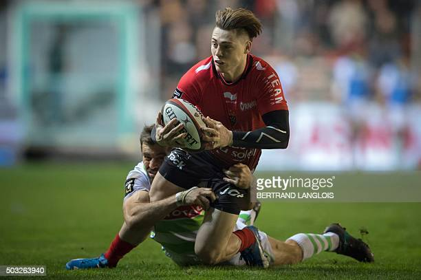RC Toulon's Australian fullback James OConnor is tackled by Pau's New Zealand centre Conrad Smith during the French Top 14 rugby union match RC...