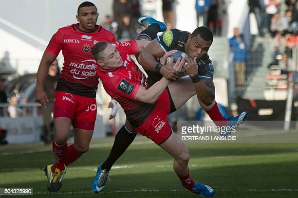 RC Toulon's Australian fullback James OConnor vies with Bath's Fijian wing Semesa Rokoduguni during the European Champions Cup rugby union match...