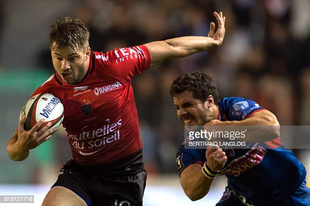 RC Toulon's Australian wing Drew Mitchell vies with Grenoble's French centre Lucas Dupont during the French Top 14 rugby union match between RC...