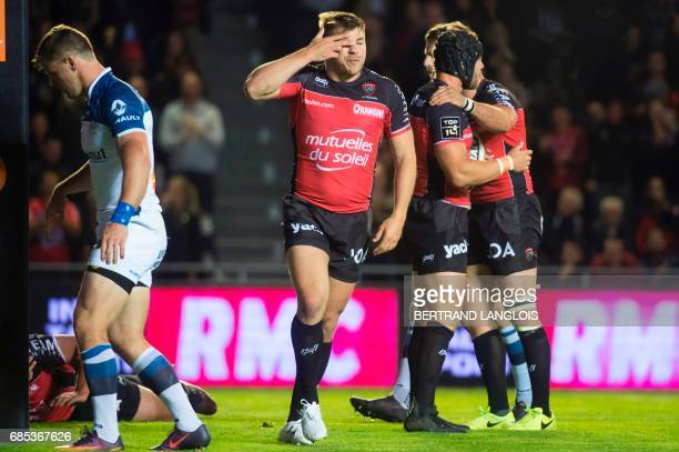 RC Toulon's Australian winger Drew Mitchell and teammates celebrate after RC Toulon's French prop Laurent Delboulbes scores a try during the French...