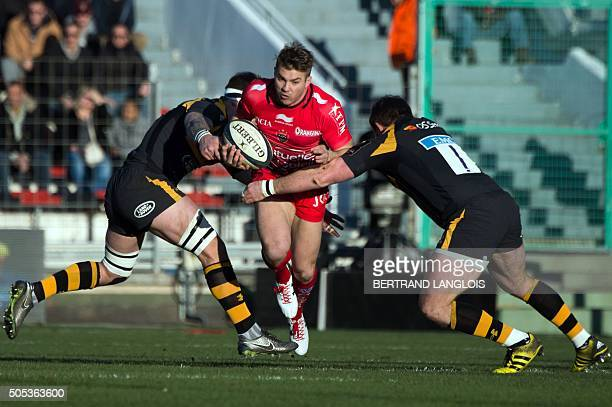 RC Toulon's Australian winger Drew Mitchell is tackled by Wasps' defenders during the European Champions Cup rugby union match RC Toulon vs Wasps on...