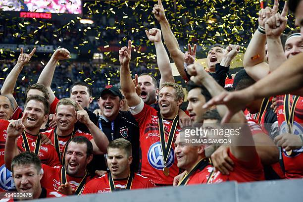 RC Toulon's British flyhalf Jonny Wilkinson celebrates with his teammates after winning the French Top 14 rugby union final match between Castres...