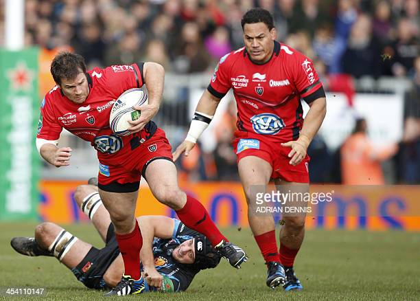 Toulon's Craig Burden evades a tackle during the European Cup rugby union match between Exeter Chiefs and Toulon at Sandy Park in Exeter on December...