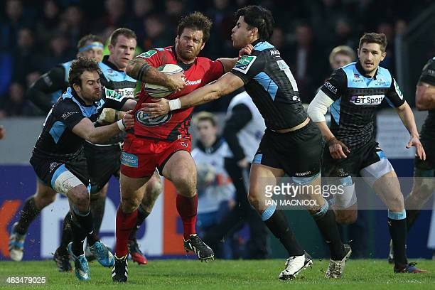 Toulon's Craig Burden is tackled by Glasgow Warriors' Sean Maitland during the European Cup rugby union match between Glasgow Warriors and Toulon at...