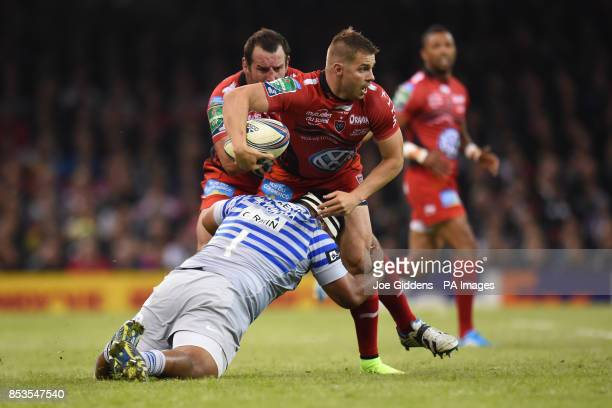 RC Toulon's Drew Mitchell is tackled by Saracens' Mako Vunipola during the Heineken Cup Final at the Millennium Stadium Cardiff