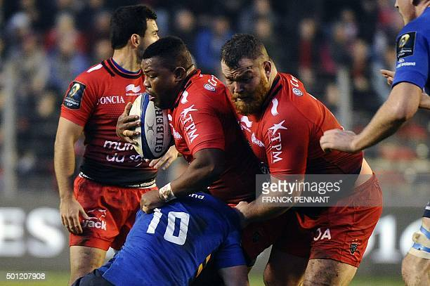 Toulon's English flanker Steffon Elvis Armitage challenges Leinster's Irish flyhalf Jonathan Sexton during the European Rugby Champions Cup rugby...