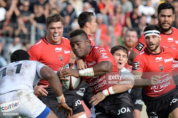 RC Toulon's Fijian wing Josua Tuisova vies for the ball with Oyonnax' Fijian wing Uwanakoro Tawalo during the French Top 14 rugby union match between...