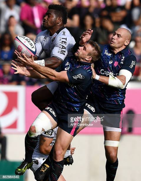 RC Toulon's Fijian winger Josua Tuisova grabs the ball next to Stade Francais Paris' Italian Number Eight Sergio Parisse and RC Toulon's French...