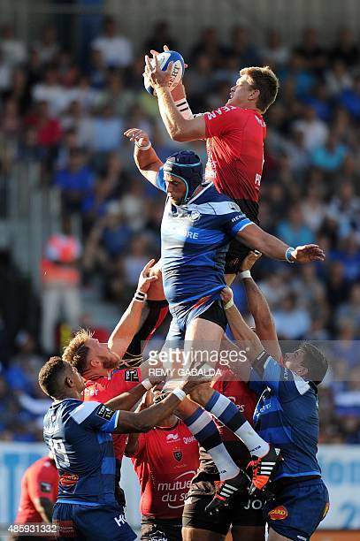 Toulon's flanker and captain Juan Smith grabs the ball in a line out during the French Top 14 rugby union match Castres vs Toulon on August 30 2015...