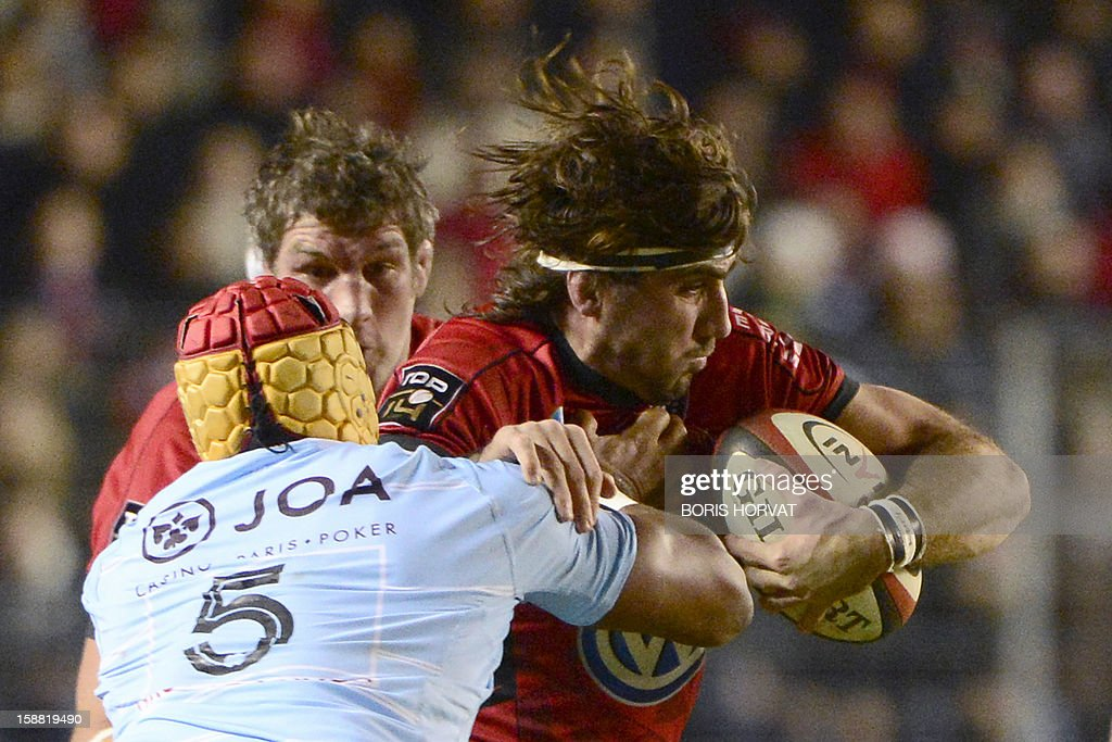 RC Toulon's flanker Juan-Martin Fernandez (R) vies with Perpignan lock Robins Tchale-Watchou (L) during the French Top 14 rugby Union match RC Toulon versus Perpignan, on December 30, 2012, at the Mayol stadium, in the French southern city of Toulon. AFP PHOTO / BORIS HORVAT
