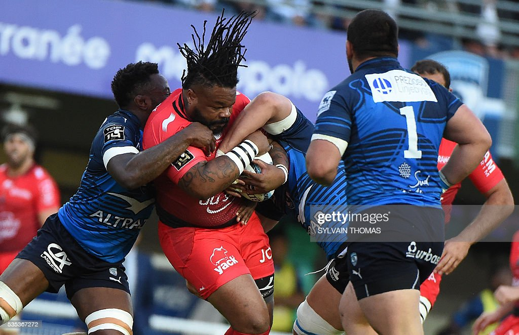 Toulon's French centre Mathieu Bastareaud (2nd L) is tackled by Montpellier's French flanker Fulgence Ouedraogo (L) during the French Top 14 rugby union match between Montpellier and Toulon, on May 29, 2016, at the Altrad Stadium in Montpellier, southern France.